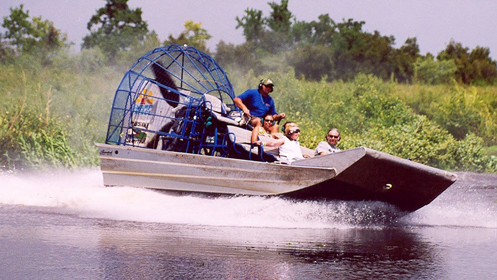 Airboat turning on creek in New Orleans
