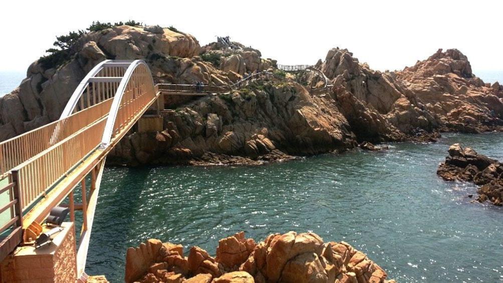 Bridge out to small rocky island of Daewangam park in Ulsan