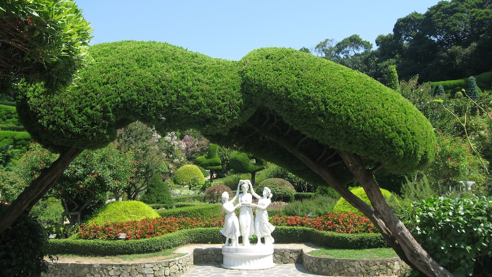Show item 5 of 5. Statues and vegetation in Oedo Botania.