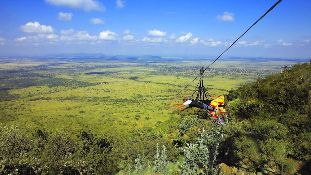Show item 3 of 5. Person zip lining in South Aftrica