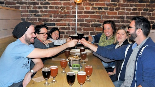 Group toasting with beer at a bar in San Francisco
