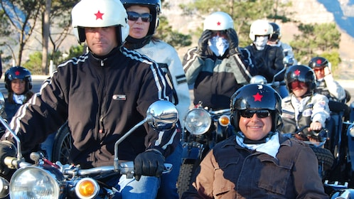 Motorcyclists and people in sidecarts