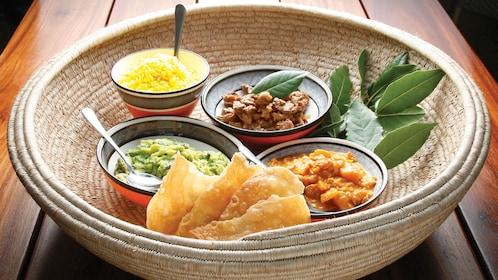 A basket of bowls of food