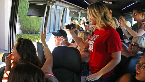 Tourists and tour guided taking pictures and video on the TMZ Celebrity Tour in Los Angeles