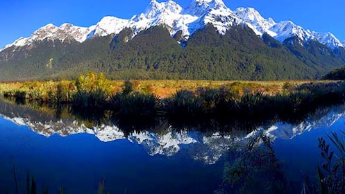 Mountains with reflection on a river
