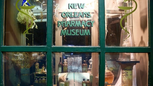 View into Pharmacy Museum through window in New Orleans