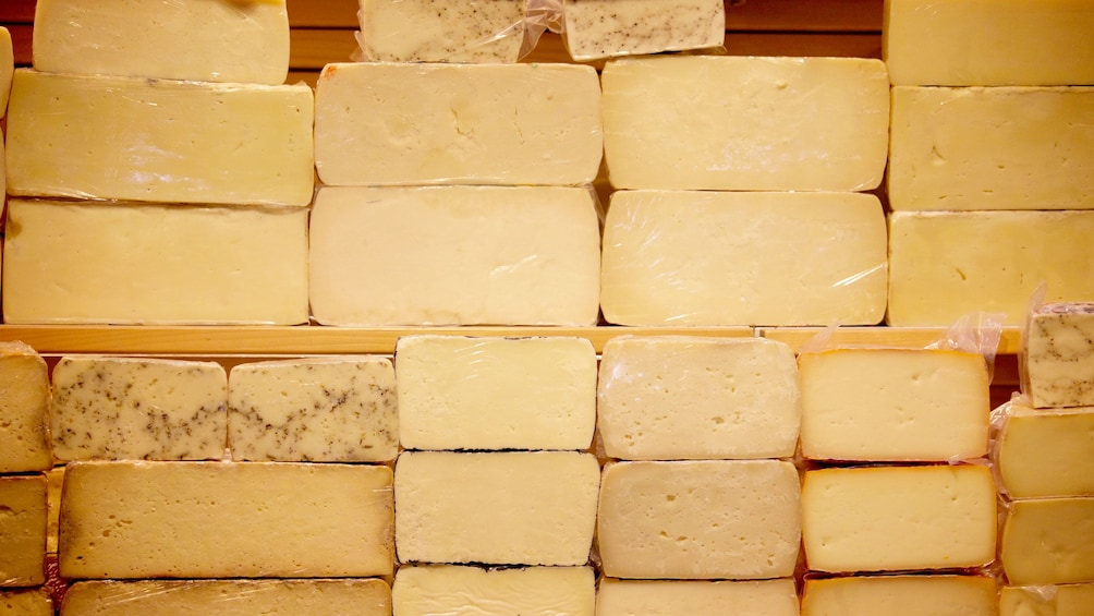 Stacks of different cheeses seen on Athens food tour