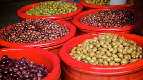 Buckets of different olives on Athens food tour
