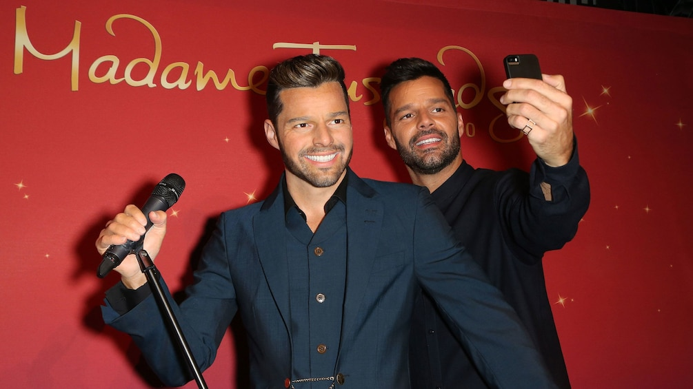 Show item 6 of 6. Ricky Martin taking a selfie with a wax figure Ricky Martin at Madam Tussauds in Orlando