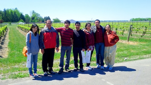 Group poses for a picture outside a Niagara Vineyard