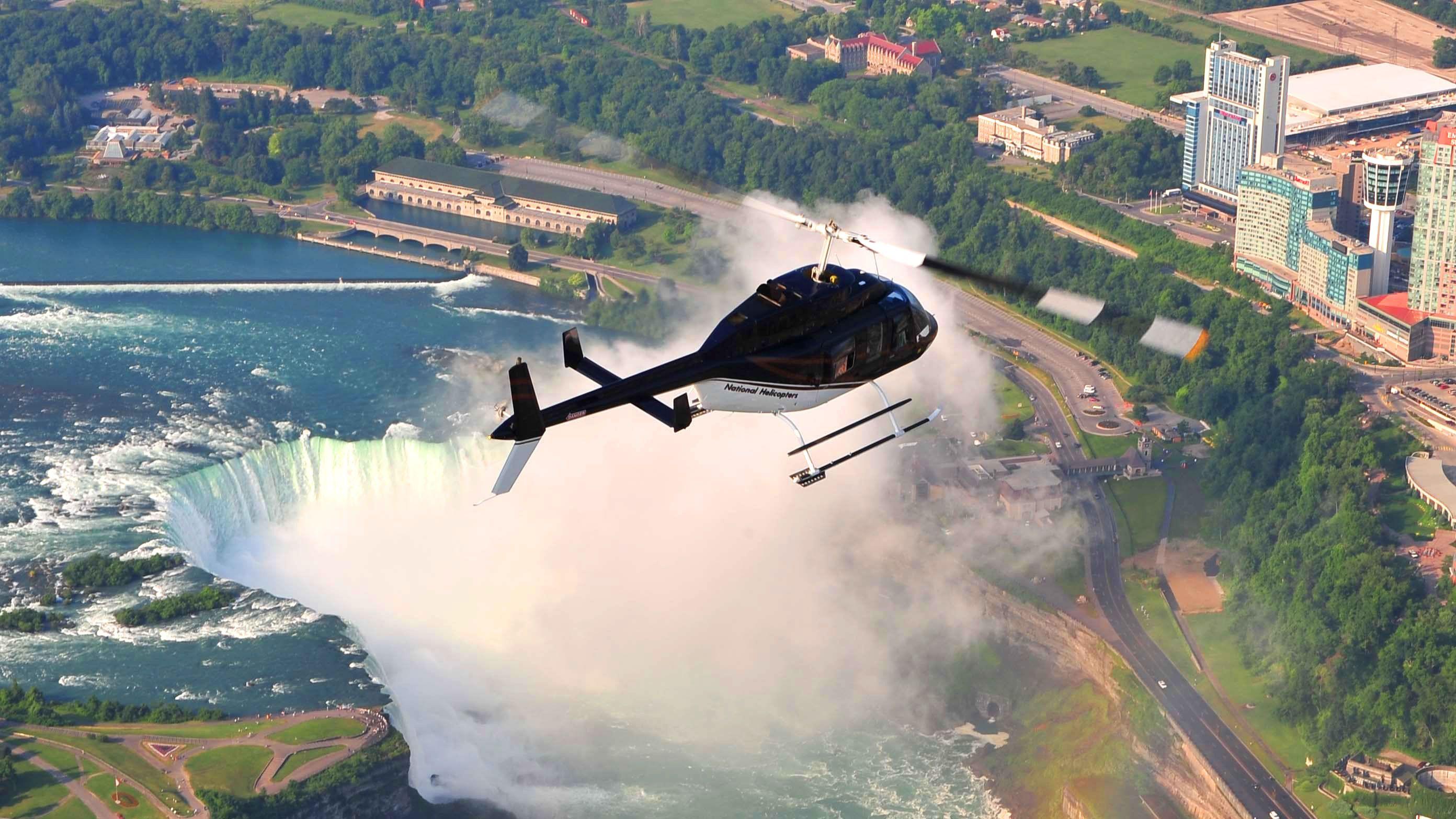 Helicopter flies above Niagara Falls