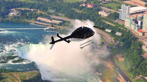 Helicopter flying above Niagara Falls
