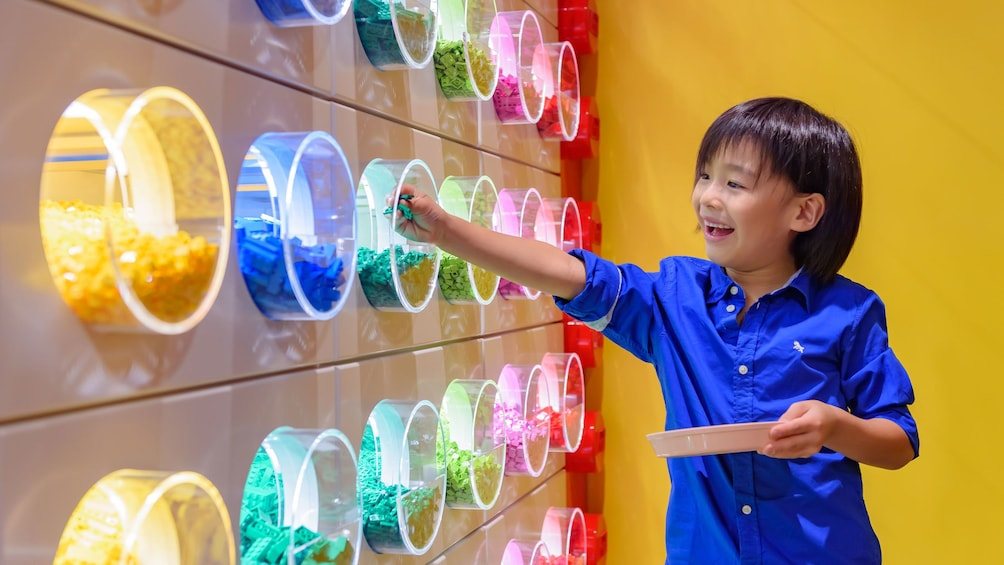 Young child picking out legos at Legoland Discovery Center Tokyo