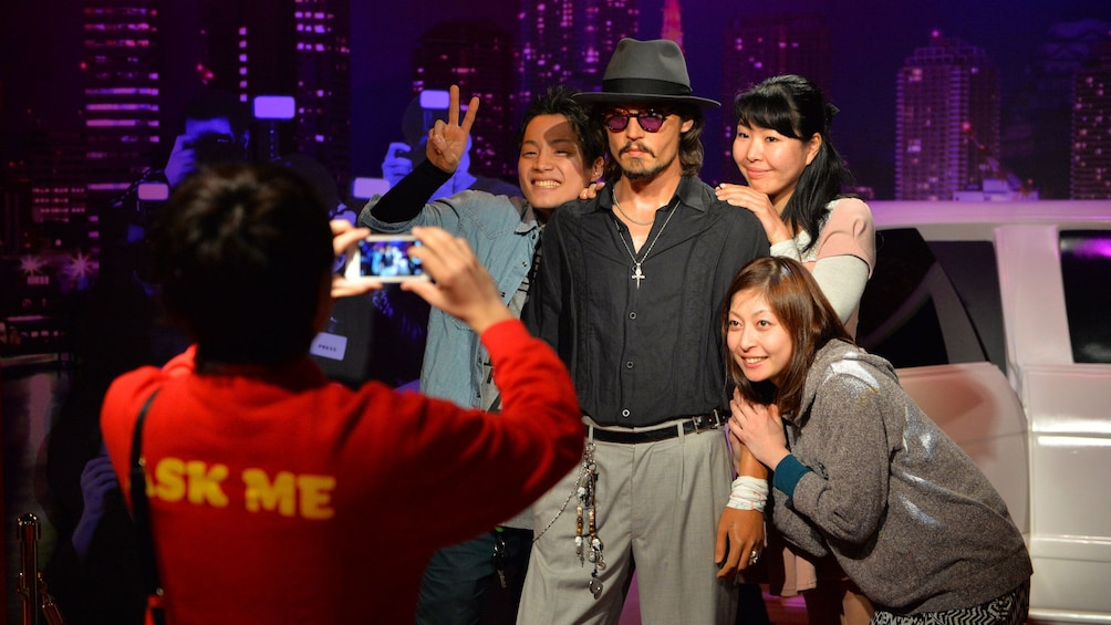 Show item 1 of 4. Group having picture taken with figure at Madame Tussauds Tokyo