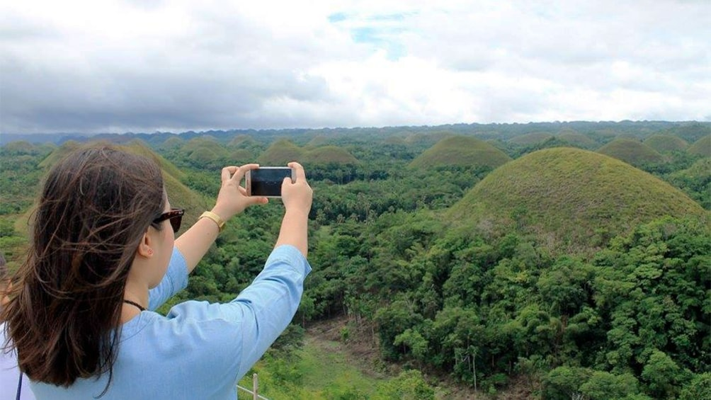 Show item 1 of 5. Woman taking a photo on the Bohol Daytour from Cebu