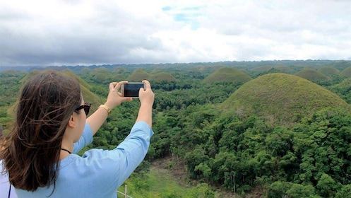 Woman taking a photo on the Bohol Daytour from Cebu
