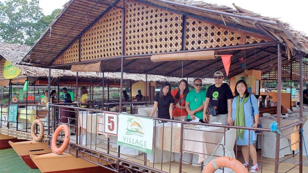 Show item 5 of 5. Tour group getting ready to enjoy a meal on the Bohol Daytour from Cebu