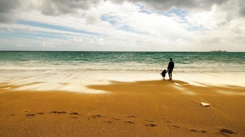 Father and child on the beach along the Amalfi Coast