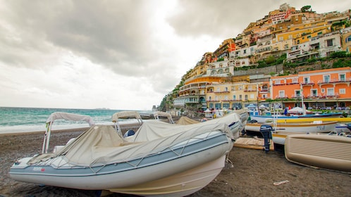 Beach scene with the city in the background on the Amalfi Coast