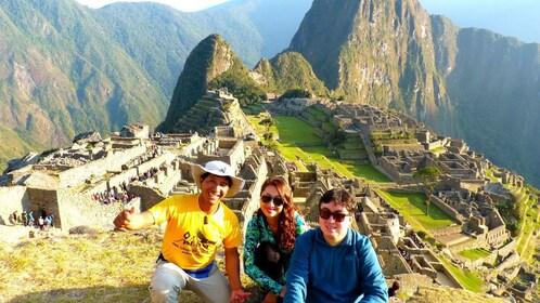 Tourist pose in front of Machu Picchu in Peru