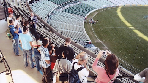 Tour group at a stadium in Melbourne