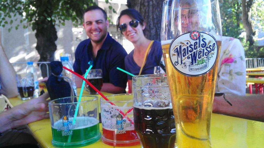 Åpne bilde 1 av 5. Group of people drinking Beer in Berlin