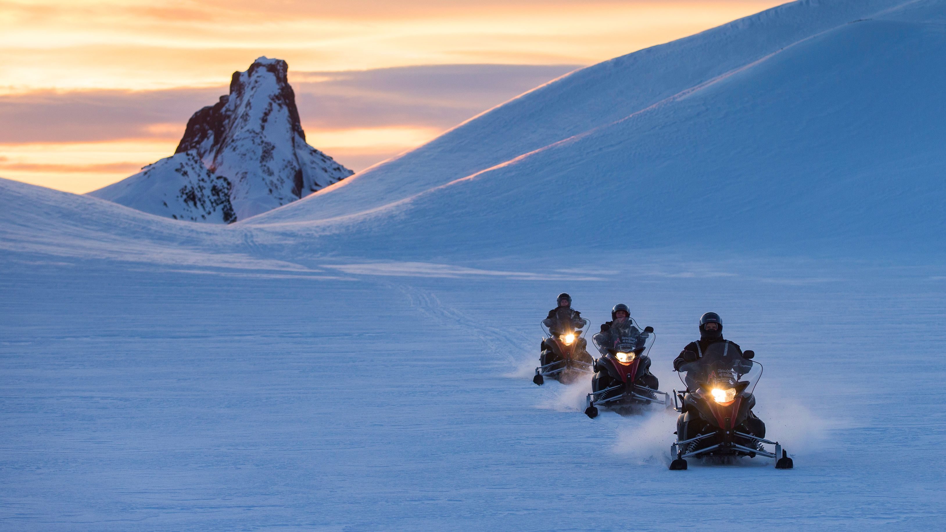 Snowmobilers in the mountains