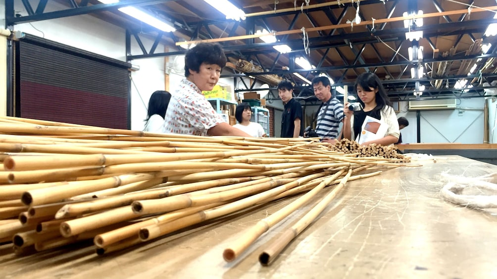 Show item 5 of 5. Table view of bamboo on the Kyoto style Kasumi Bamboo Mat Making tour