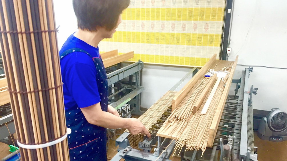 Show item 2 of 5. Woman preparing to make Kyoto style Kasumi Bamboo Mats