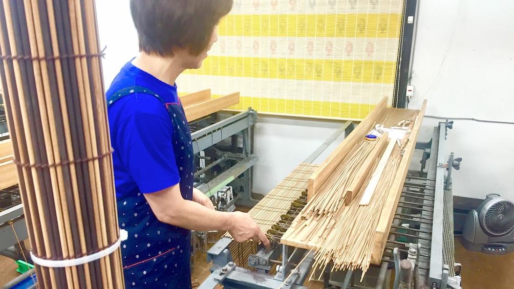 Woman preparing to make Kyoto style Kasumi Bamboo Mats