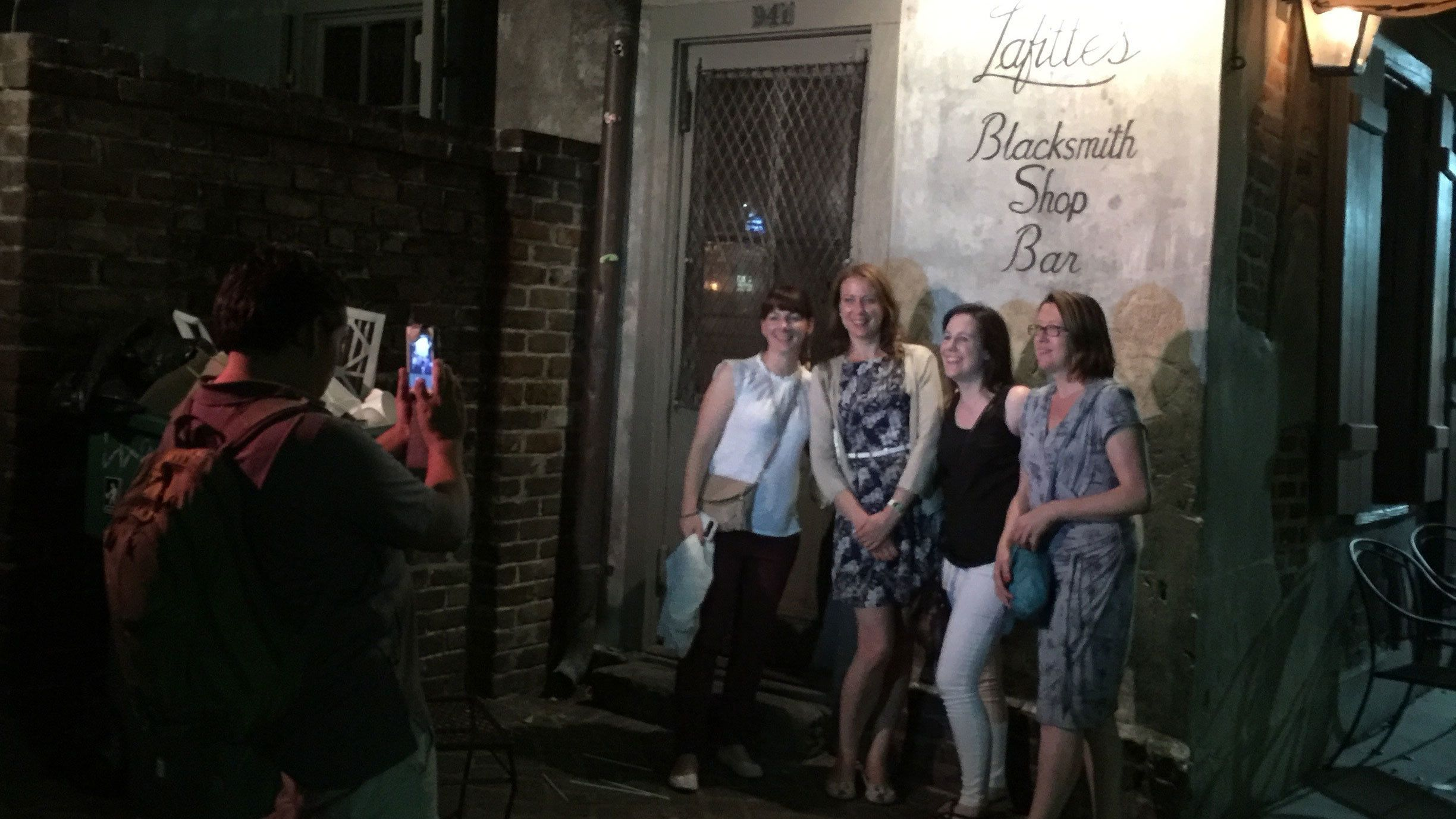 Women posing for photo outside of bar in New Orleans