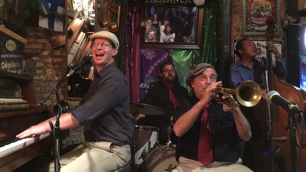 Show item 1 of 4. Musicians playing in bar in New Orleans