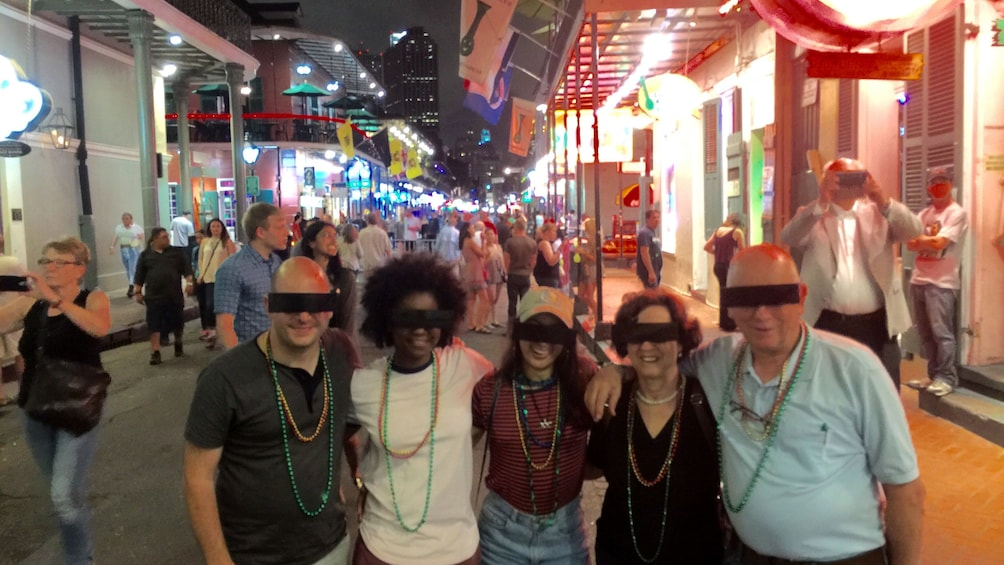Show item 4 of 4. Group posing for picture with censor bar glasses on in New Orleans