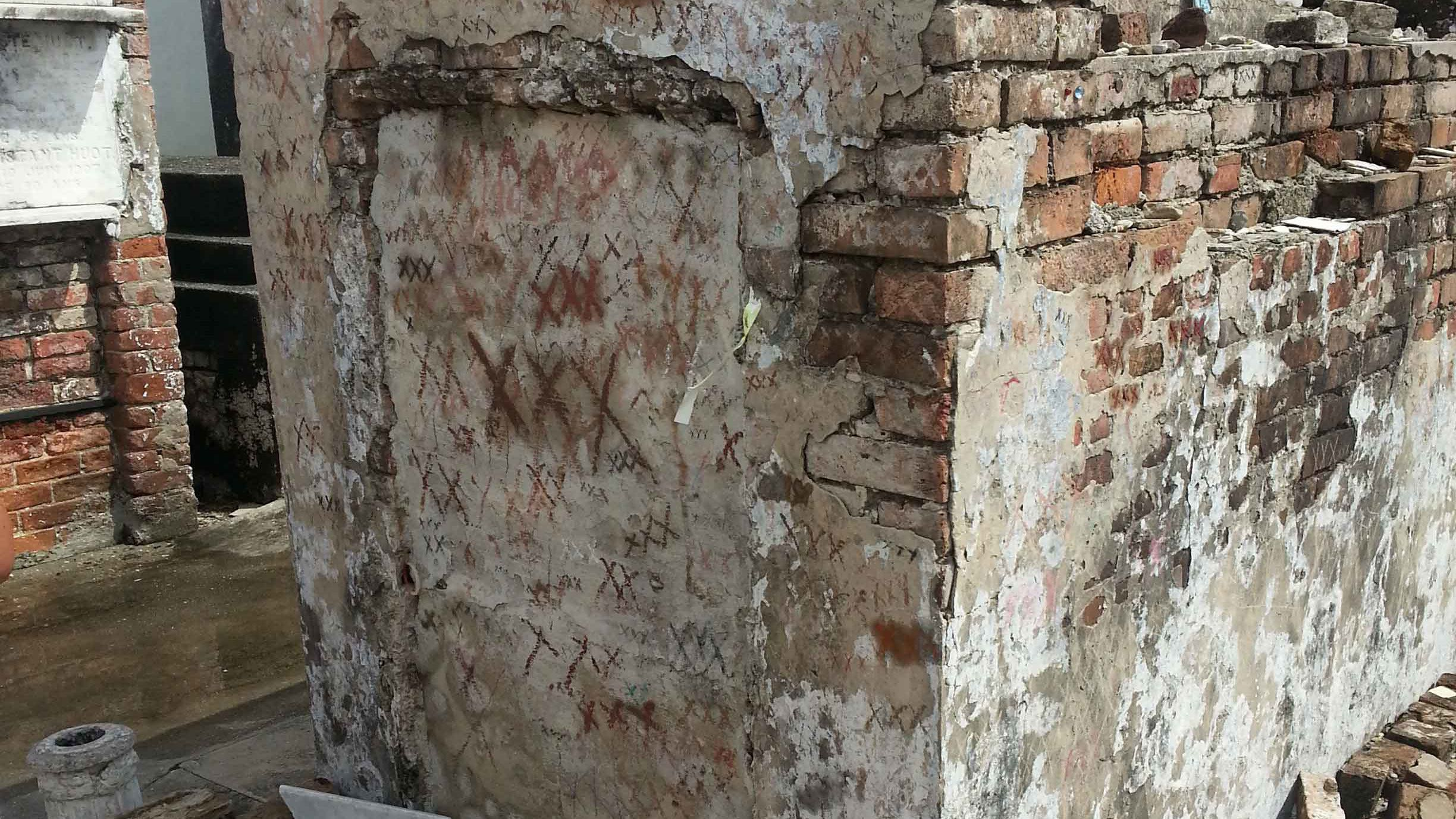 Mausoleums with X's drawn on it in Saint Louis Cemetery