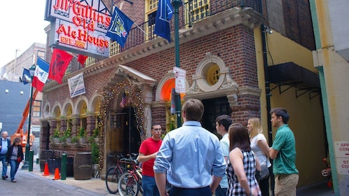 Tour guide talking to group outside of historic pub in Philadelphia