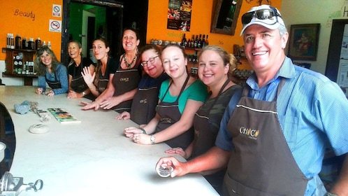 Large group at counter for chocolate making class in Guatemala City