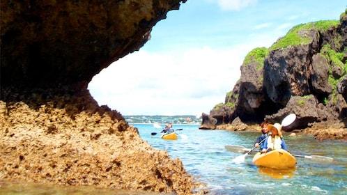 Group enjoying the scenic Cliffside Kayaking Adventure Tour in Okinawa, Japan