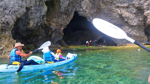 Group having fun on the Cliffside Kayaking Adventure Tour in Okinawa, Japan