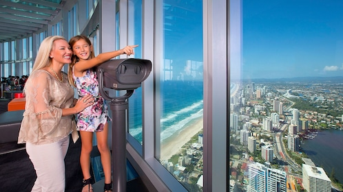 Woman and child look at the skyline from Gold Coast