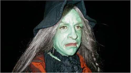 A woman dressed as a Witch