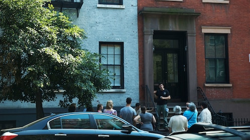 Tour guide talking to group on culture walk in Greenwich Village