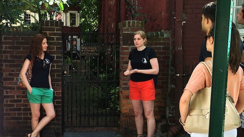 Two tour guides talking about location on culture walk in Greenwich Village