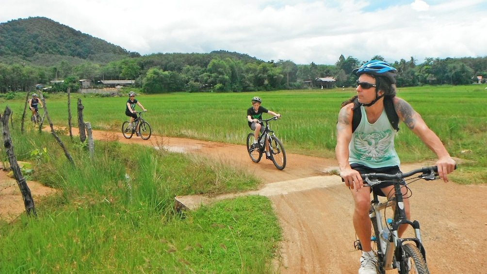 Show item 3 of 5. Guests having fun on the Yao Island cycling tour