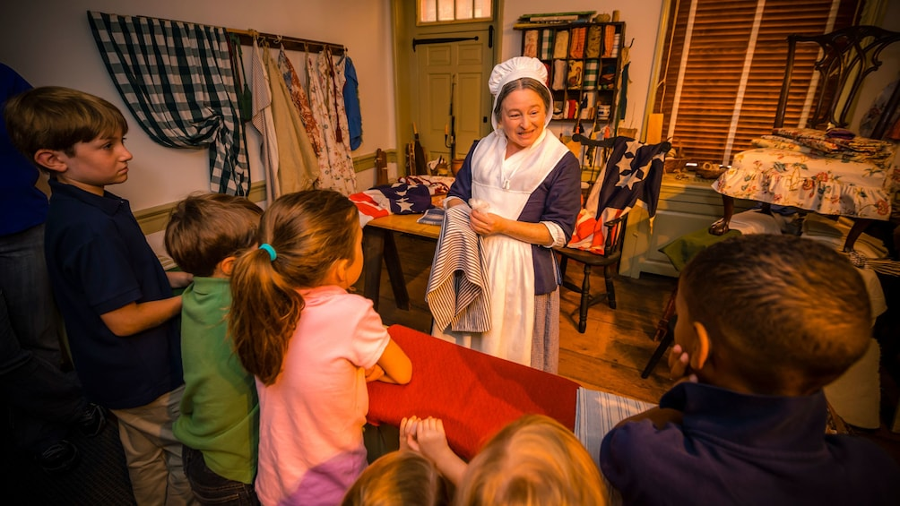 Show item 5 of 5. Betsy Ross actress talks to children on tour of home in Philadelphia