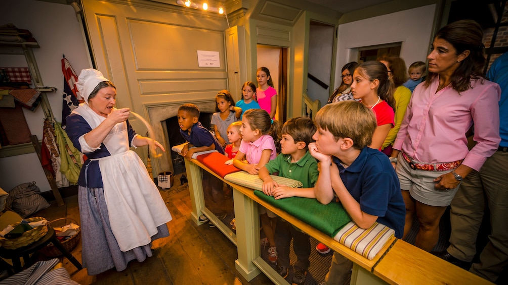 Show item 2 of 5. Betsy Ross actress talks to children on tour of home in Philadelphia