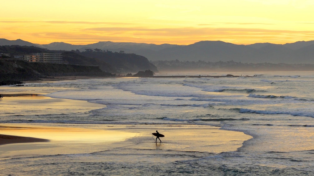Surfer on the beach in San Sebastian