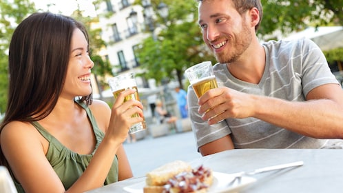 Couple enjoying beer and tapas in Spain