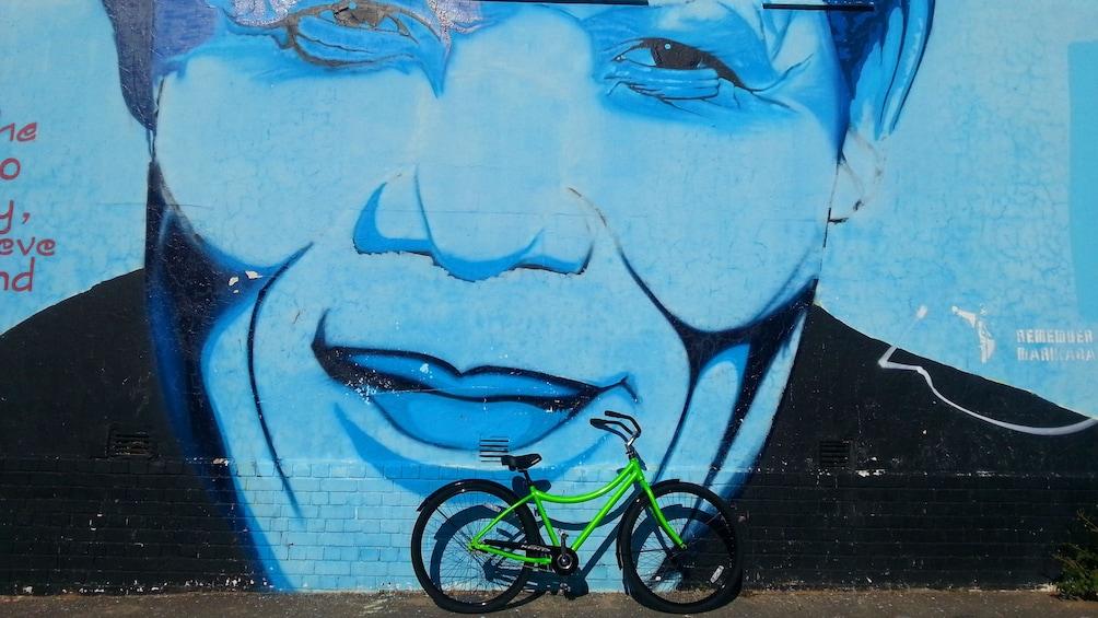 Bike next to a Nelson Mandela mural
