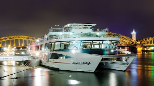 Cruise ship moored for evening cruise in Cologne