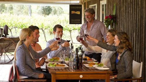 Table of people eating a vineyard